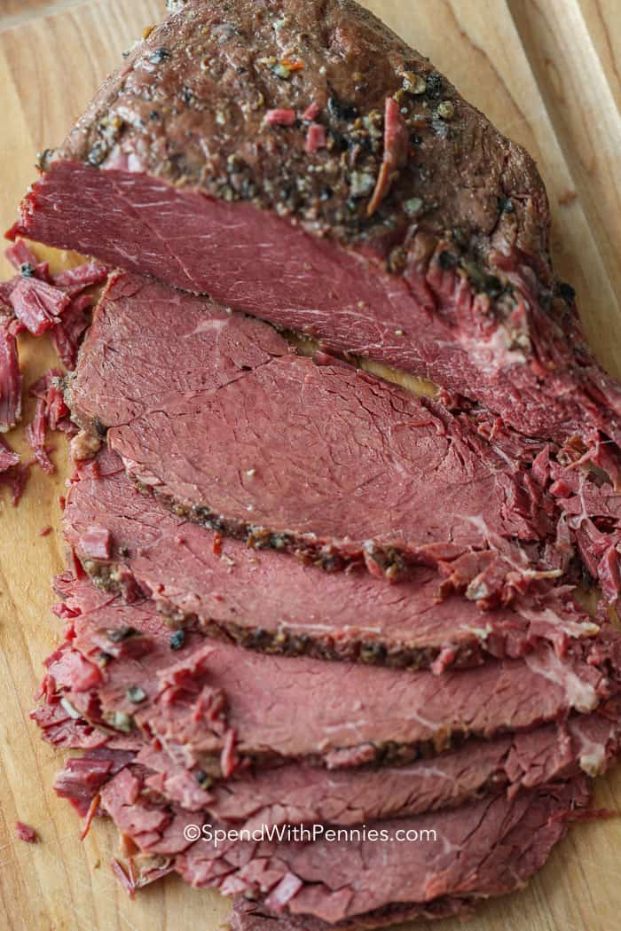 Sliced Corned Beef on a cutting board ready to serve