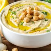 Hummus in a white bowl