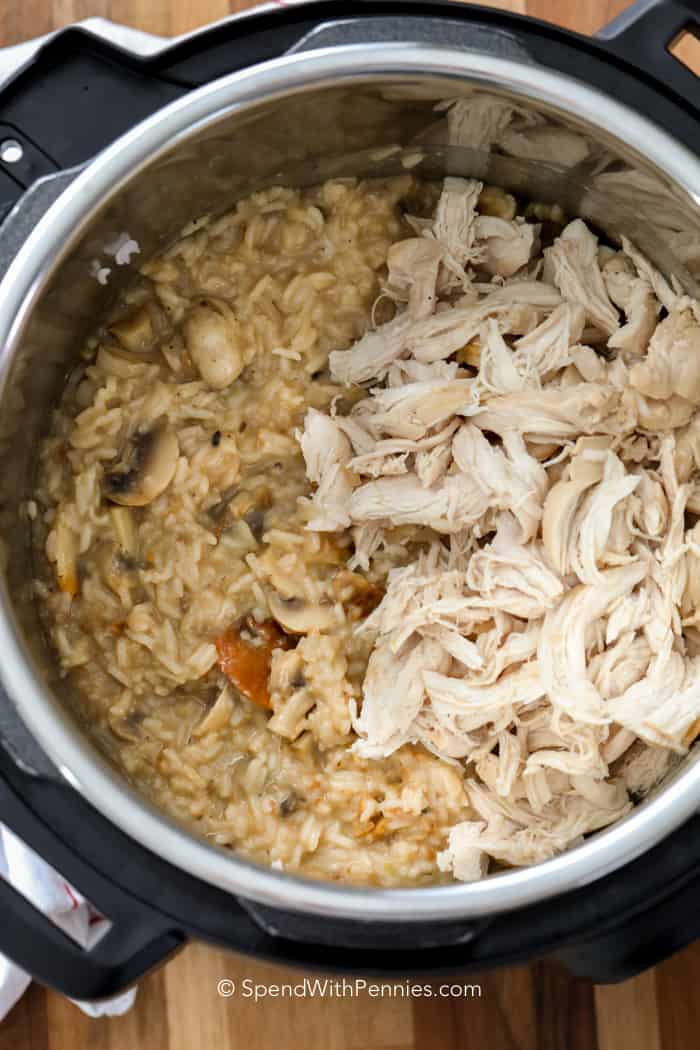 Instant Pot chicken and rice in a pressure cooker with creamy rice and shredded chicken.