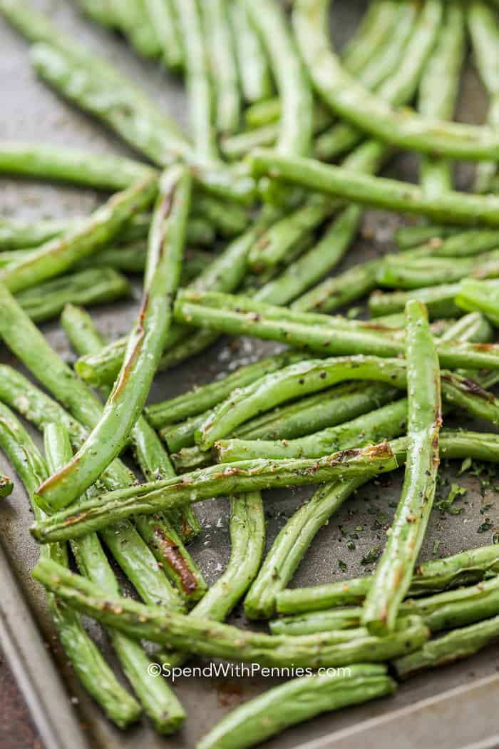 Roasted green beans on a sheet pan ready to serve