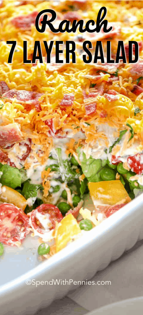 7 Layer Salad is a favore recipe with layers of lettuce, peas and bacon. The dressing is a very simple ranch dressing for a perfect meal or side! #spendwithpennies #7layersalad #madeaheadrecipe #potluck #potluckrecipe
