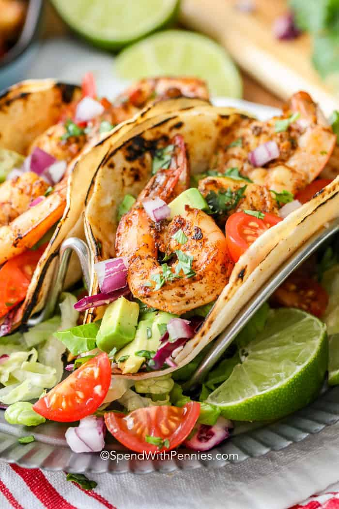 Shrimp tacos stuffed with succulent shrimp, avocado, slaw and onions