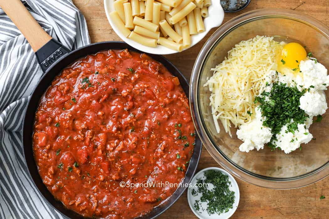 Ingredients prepared to make baked ziti with ricotta cheese and meat sauce