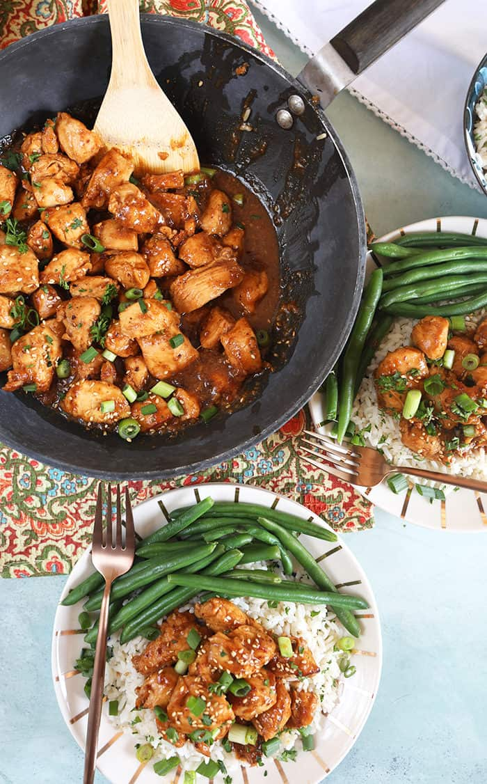 Teriyaki Chicken being served from a pan with green beans