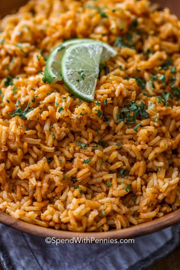 Rice cooked and topped with cilantro and lime