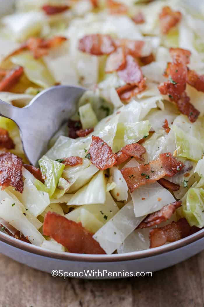 Fried cabbage and bacon in a serving dish