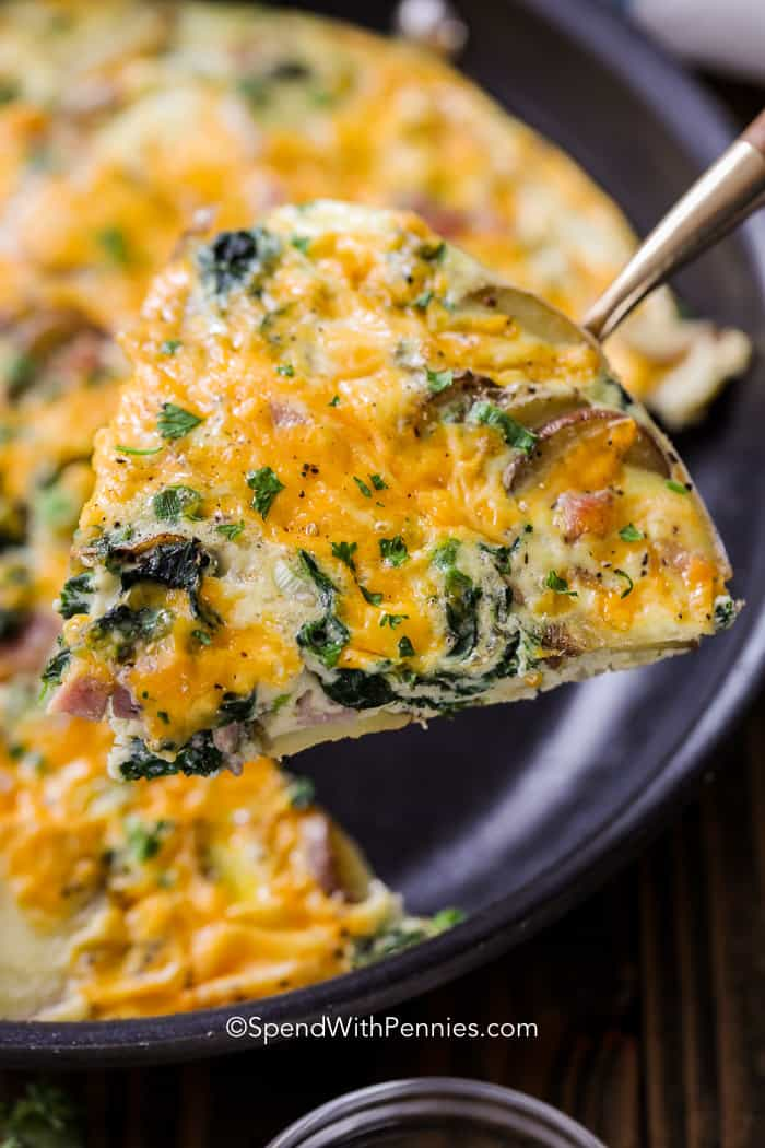 A cheesy slice of spinach frittata baked and ready to serve.