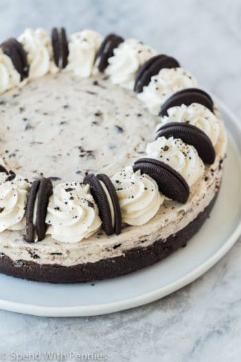 no bake oreo cheesecake whole on a white plate