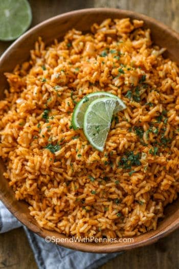 Mexican Rice in a bowl and topped with cilantro and lime