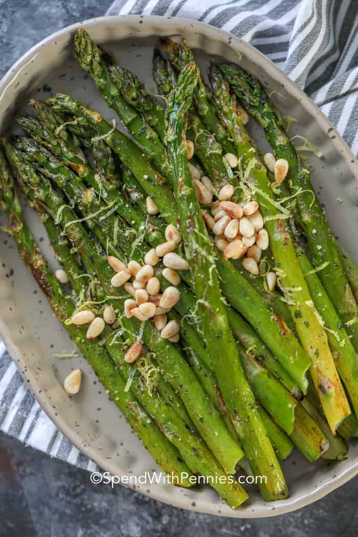 Roasted asparagus topped with pine nuts and lemon zest