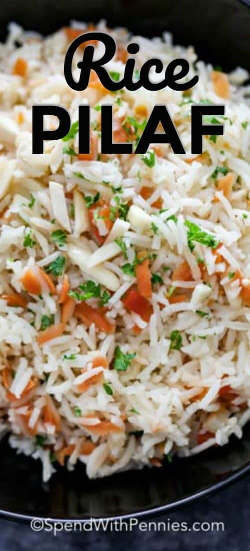 A serving bowl filled with rice pilaf topped with fresh parsley.