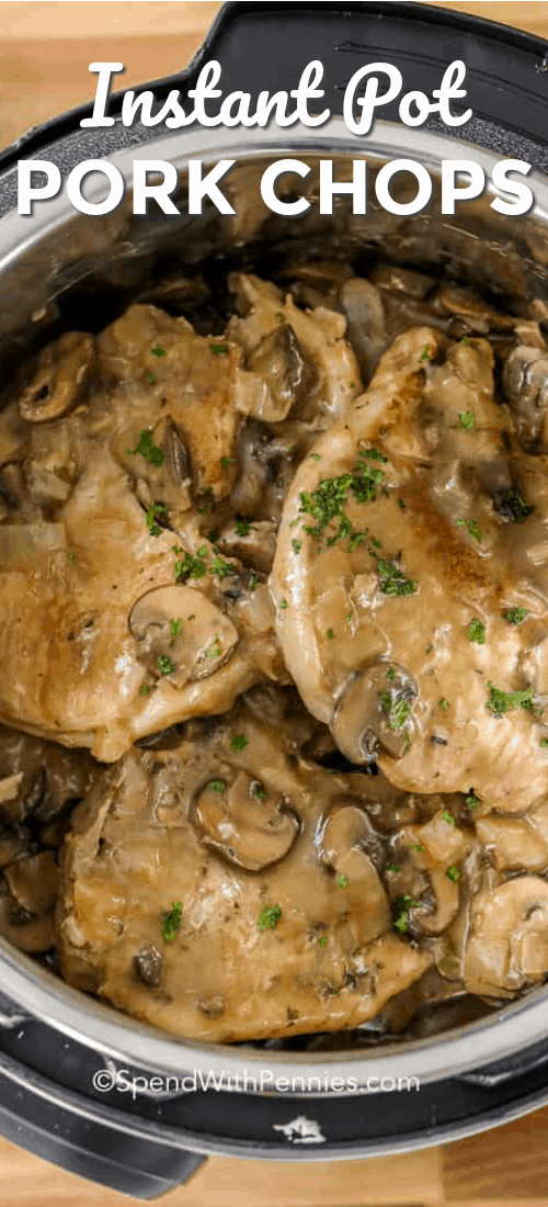 Instant Pot pork chops smothered in gravy and topped with parsley ready to be served.