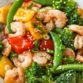 Shrimp stir fry in a white bowl