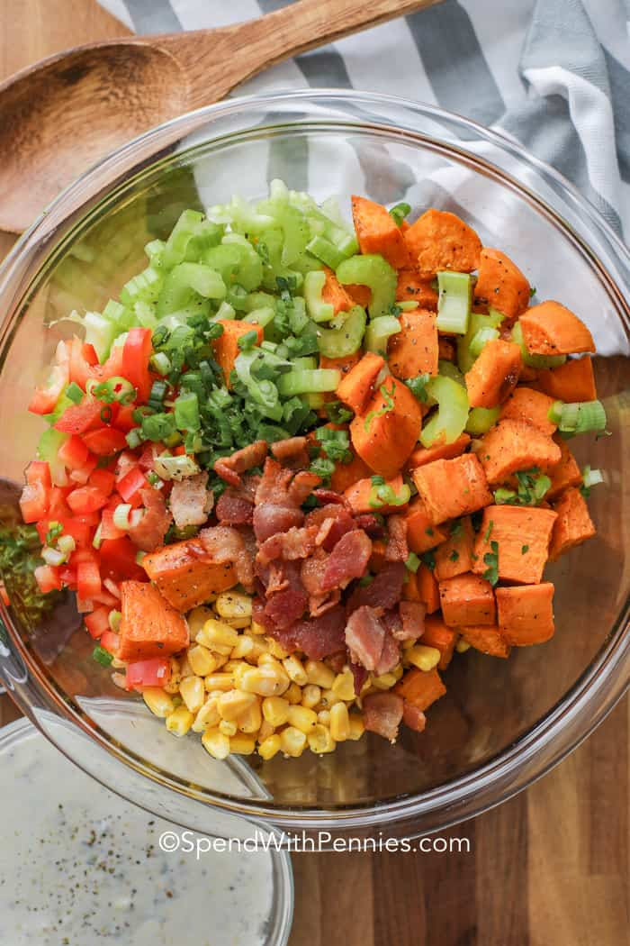 Ingredients for our favorite sweet potato salad recipe including roasted sweet potatoes, corn, peppers and bacon.