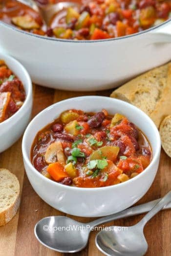 Vegetarian Chilli in a bowl with spoons and bread