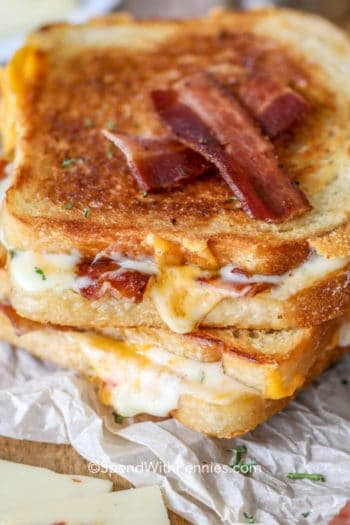 Bacon Grilled Cheese sandwiches on parchment paper