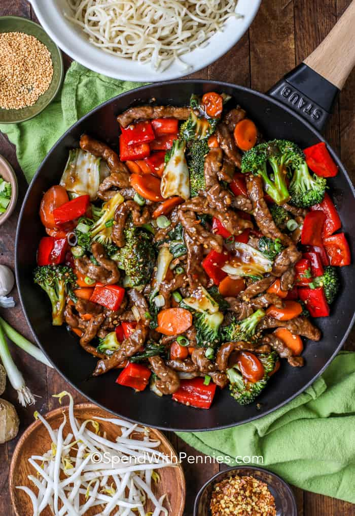 Overhead shot of Easy Beef Stir Fry in a pan surrounded by ingredients