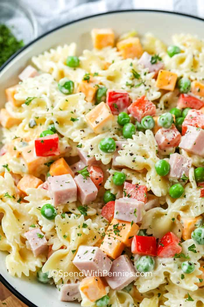 Close up of a prepared bow tie pasta salad in a creamy dressing