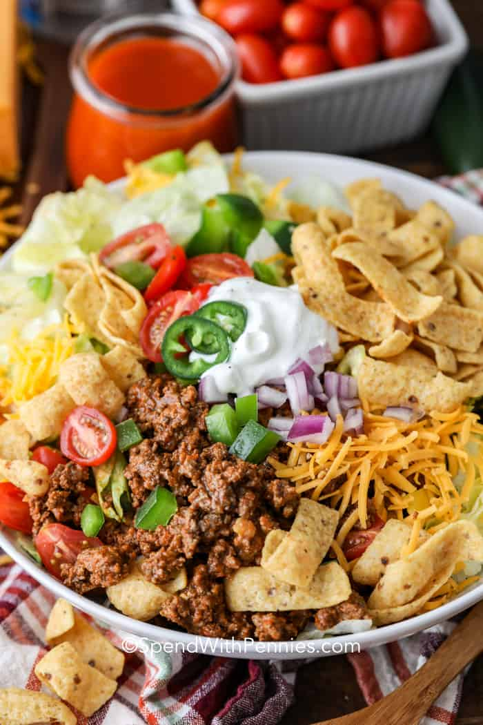 Frito Taco Salad in a bowl with toppings