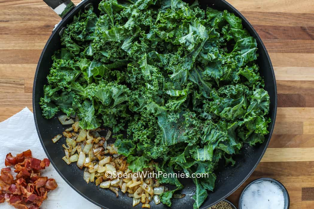 kale in a frying pan ready to be sauteed