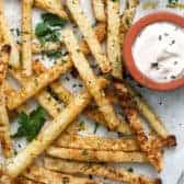 Jicama Fries on a sheet pan with parsley