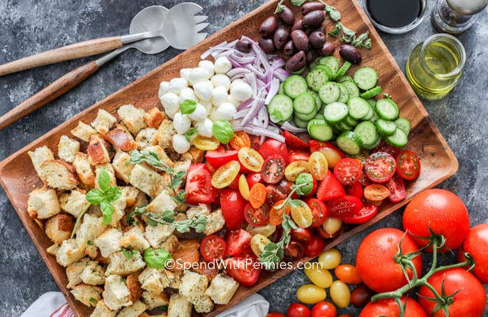 All Panzanella Salad ingredients laid out on a wooden tray.