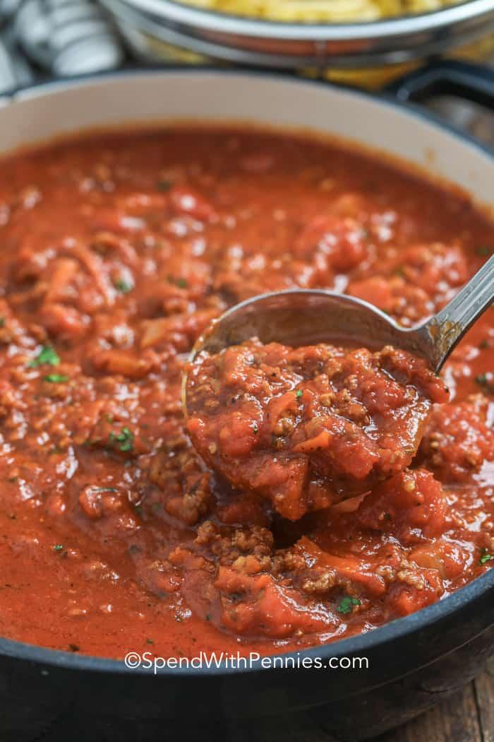 Big pot of spaghetti sauce with a ladle