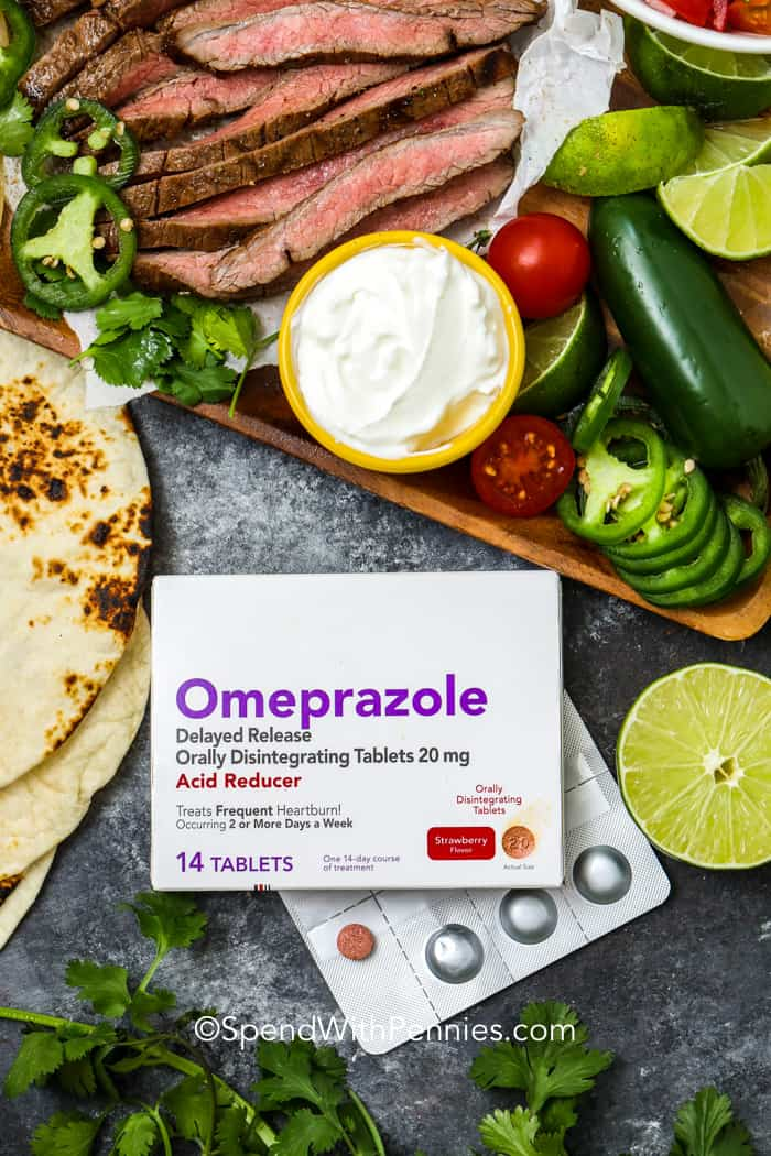 Overhead shot of package of Omeprazole acid reducer surrounded by steak fajita fixings