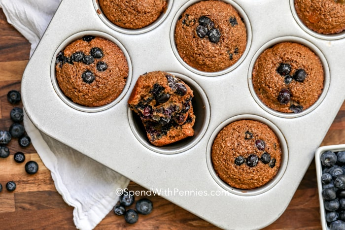 Blueberry bran muffins baked in a muffin tin.