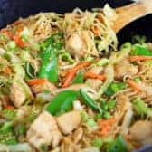 Chicken chow mein in a bowl with some being scooped out