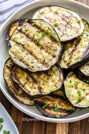 stack of Grilled eggplant on a white plate
