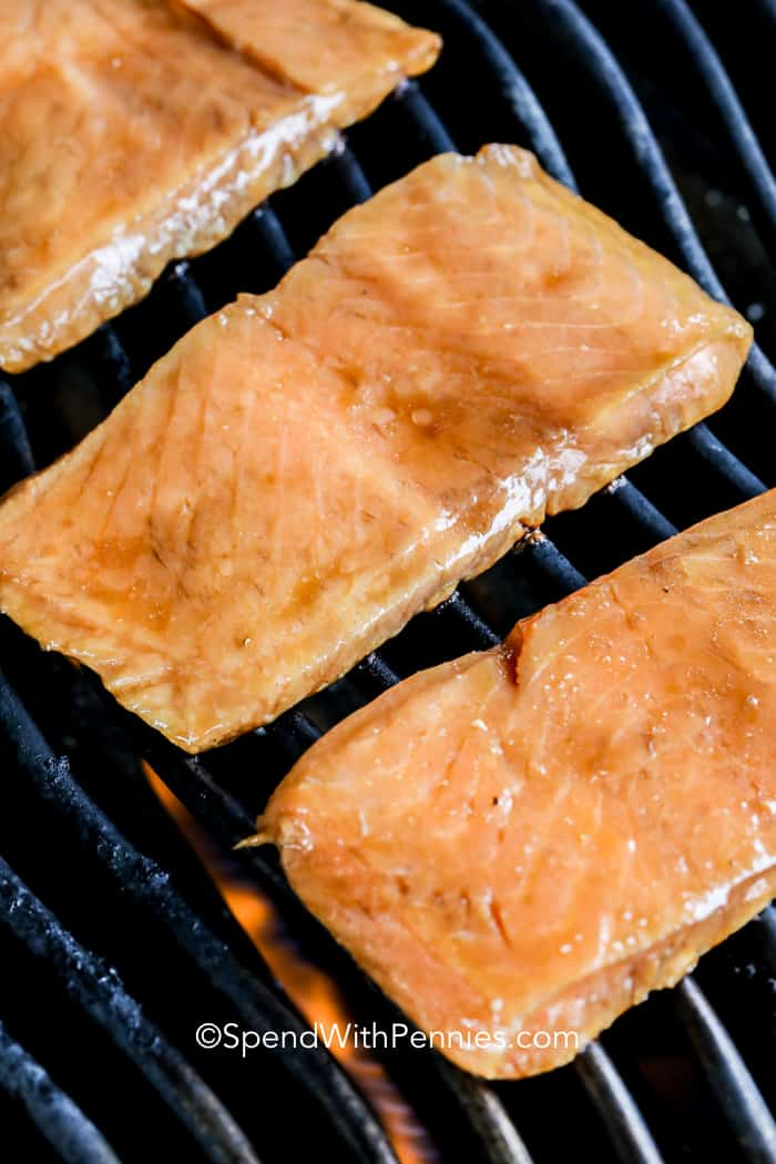Marinated Salmon fillets on a grill.