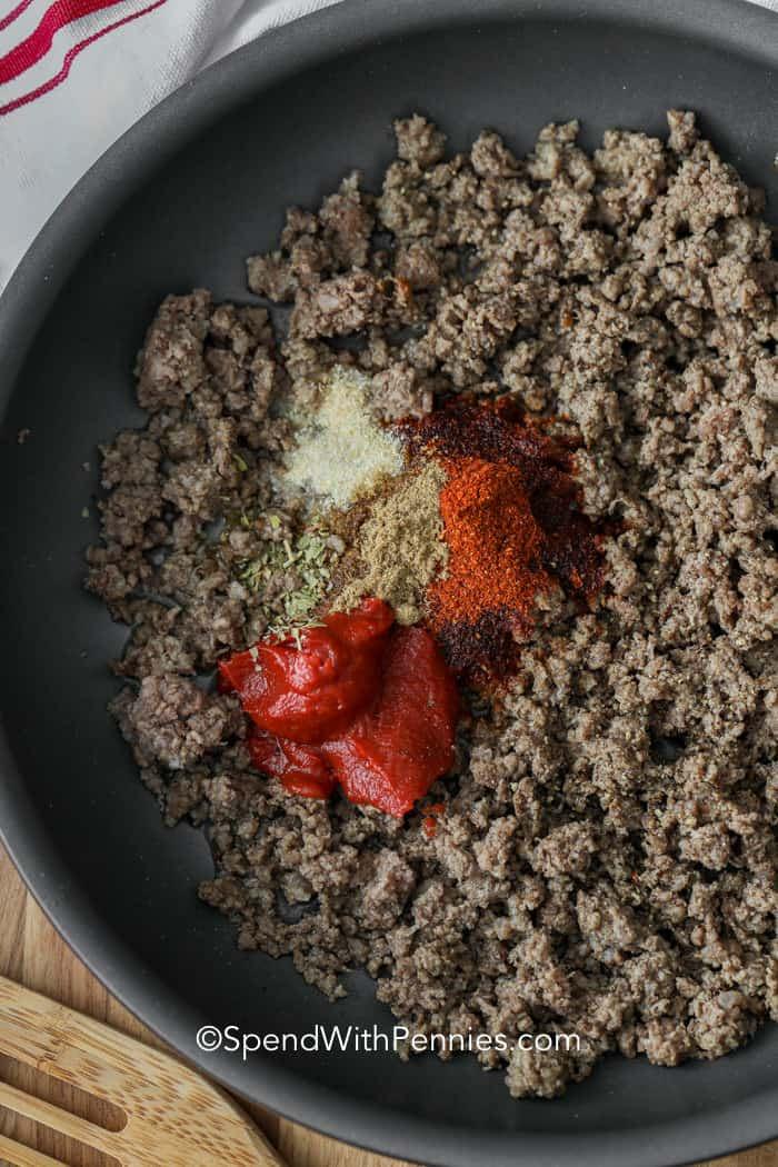 Ground beef and seasoning in a pan for ground beef tacos