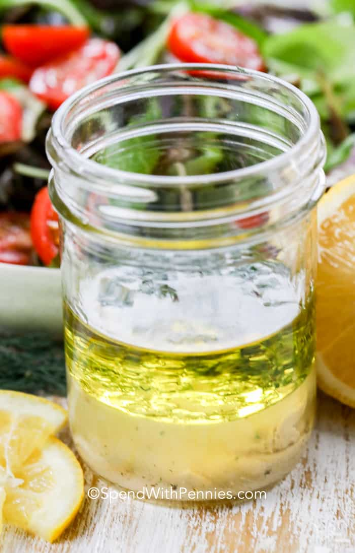 Ingredients for an easy Lemon vinaigrette dressing recipe layered in a mason jar