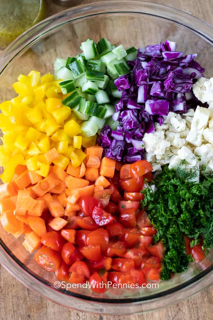 Bowl full of marinated chopped salad ingredients.
