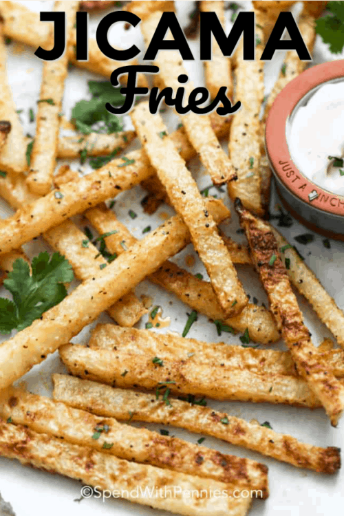 Jicama Fries on a baking sheet with writing