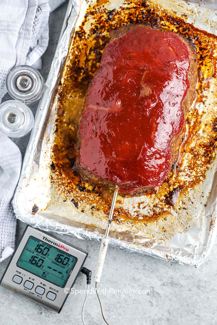 cooked meatloaf on a baking pan