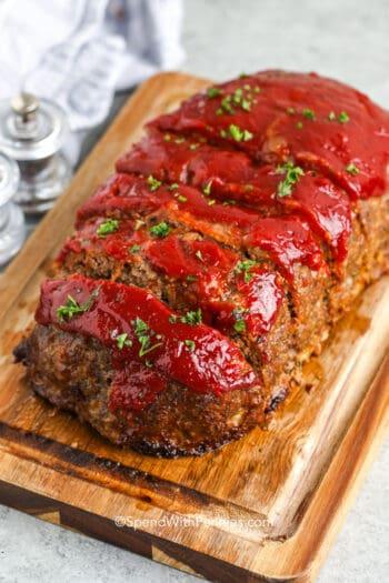 sliced meatloaf on a wood board