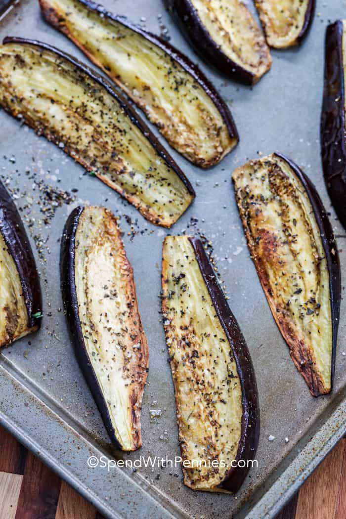 Roasted eggplant on a baking pan.