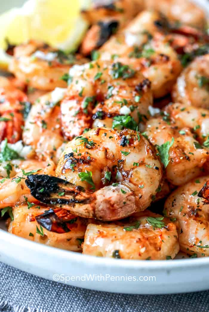 Close up of garlic grilled shrimp on a white tray.