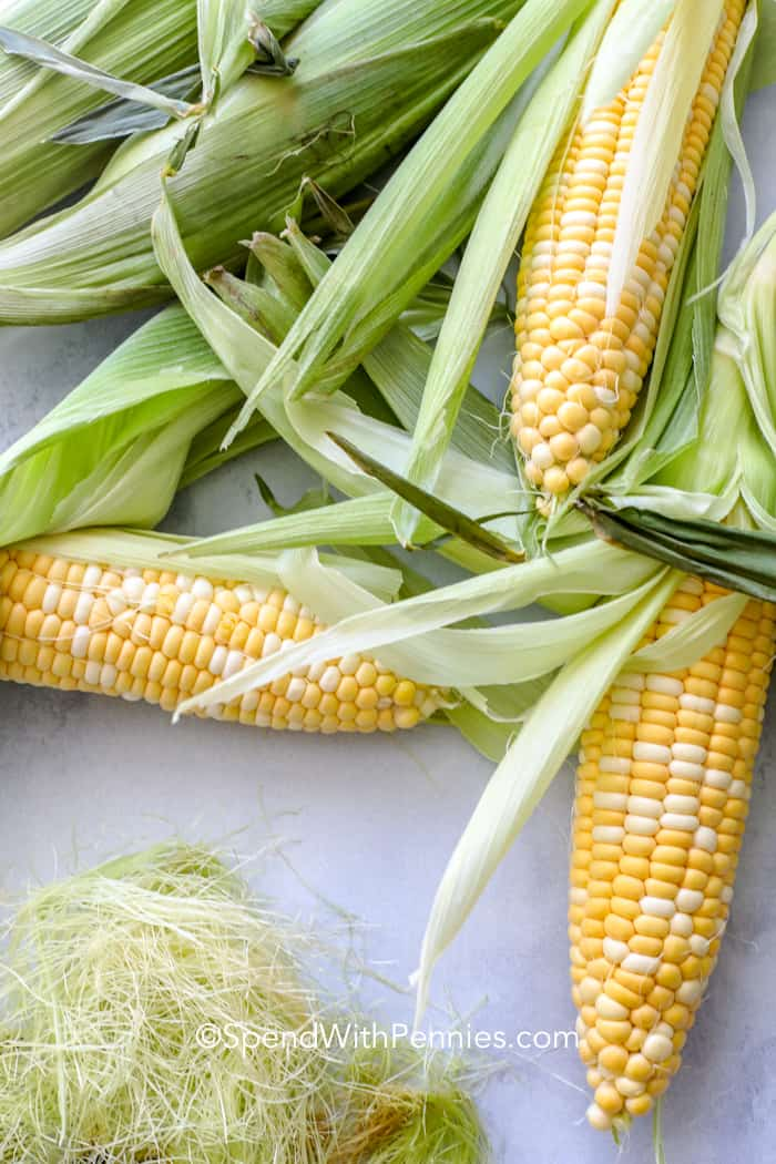 Corn on a table with the silk removed