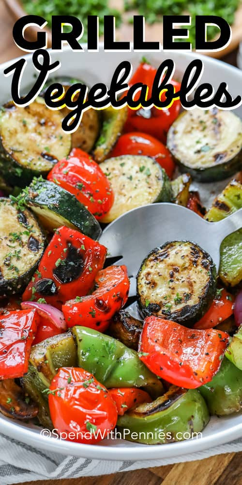 Grilled vegetables in a bowl with a spoon and a title