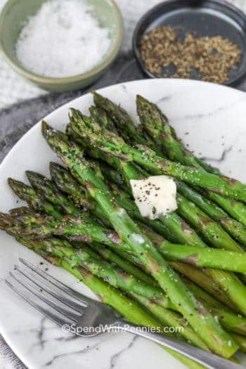 Asparagus on a plate with a fork