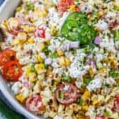 Mexican corn salad in a bowl with jalapenos as garnish