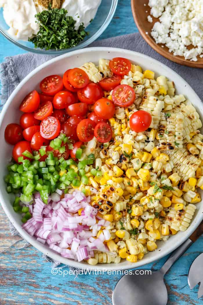 Mexican corn salad ingredients in a bowl