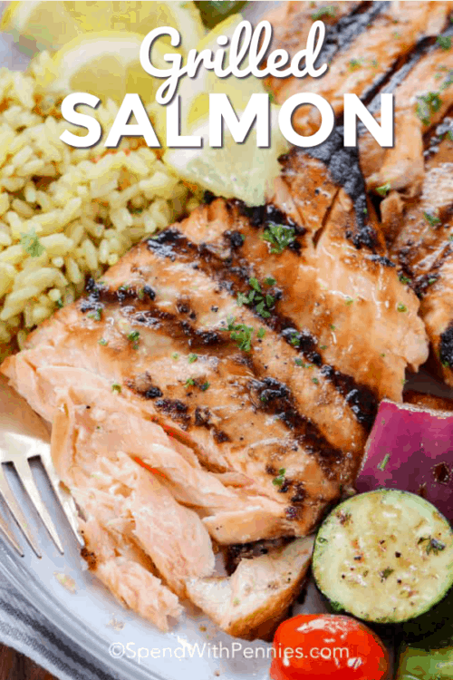 Grilled salmon on a plate with a title