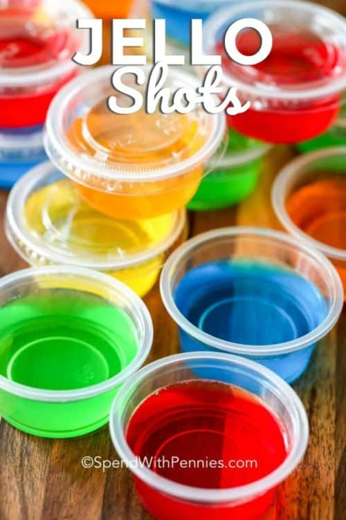 Jello shots on a wooden board with writing