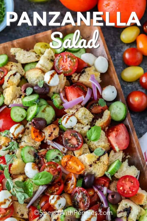 This tomato panzanella is a delicious combination of tomatoes, cucumbers and mozzarella tossed with ciabatta bread pieces and a tangy balsamic vinaigrette! I can't get enough of this fresh summer salad. #spendwithpennies #panzanellasalad #sidedish #breadsalad #mediterraneansalad #summersalad