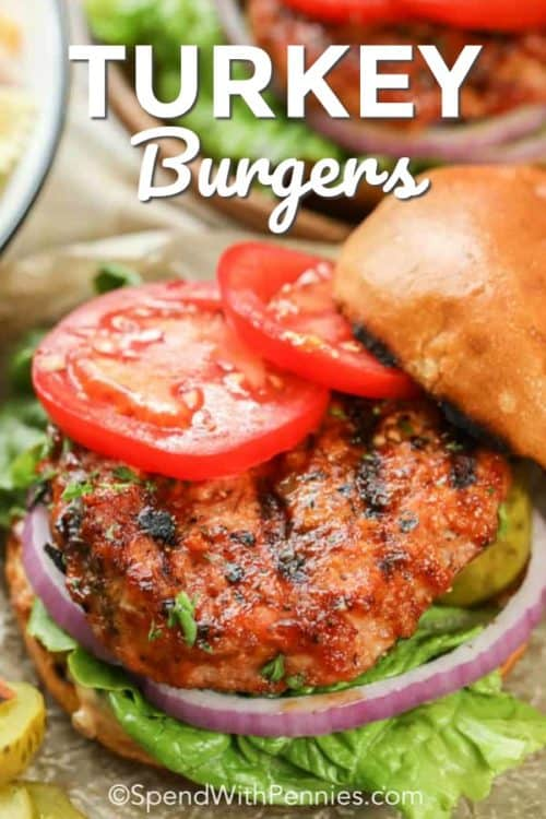 Juicy Turkey Burgers dressed with ripe tomatoes, red onion, lettuce and pickles all between a toasted bun
