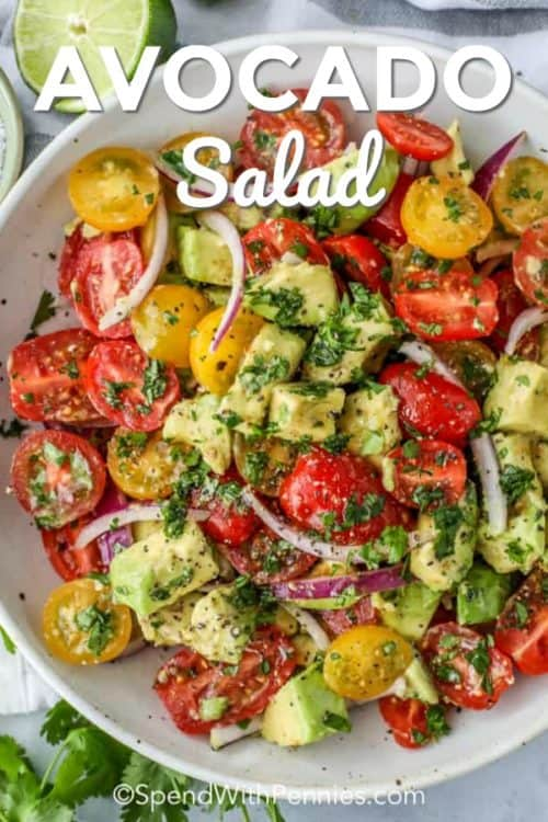Avocado salad with tomatoes and onions shown with a title